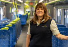 Image of Emma from Wellington Rail team on board a train